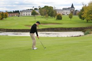 Picture of a man playing on Ballykisteen Golf course